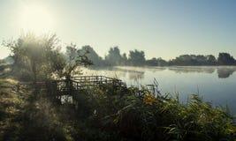 Misty sunrise over a lake summer morning Royalty Free Stock Image