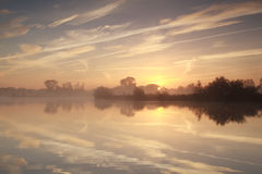 Misty sunrise over river Stock Images