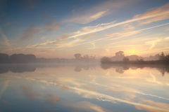 Misty sunrise over river Stock Image