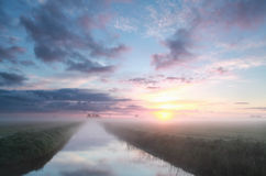Misty sunrise over river Stock Photography