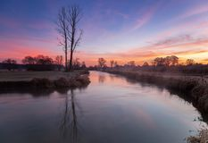 Misty sunrise in fall. Misty sunrise by the river in late fall Stock Images