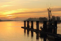 Misty Sunrise, Steveston Dock Stock Photos