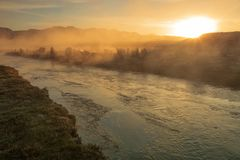 Misty sunset above a hot river, California, USA. stock photography