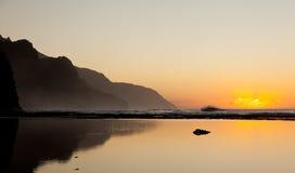 Misty sunset on Na Pali coastline stock photo