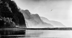 Misty sunset on Na Pali coastline Stock Photos