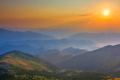 Misty sunset over a mountains Stock Photo