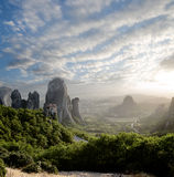 Misty at sunset on rocks of Meteora, Greece Stock Image
