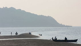 Misty tropical seascape with boats and fishermen silhouettes stock video