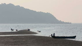 Misty tropical seascape with boats and fishermen silhouettes stock video footage