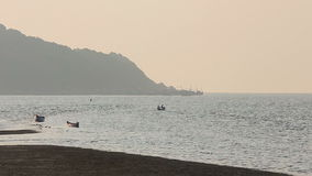 Misty tropical seascape with boats and fishermen silhouettes stock footage