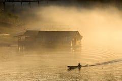 Misty tropical sunset on lake Royalty Free Stock Image