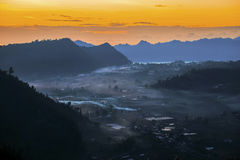 Misty valley during day break at Kintamani. Stock Images