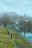 Misty village in Belgium Royalty Free Stock Photos