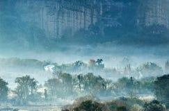 Misty village in foot of  mountain Stock Photos