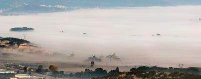 Misty village Stock Photos