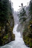 Misty waterfall in Alaska, Valdez. Wild stream Royalty Free Stock Images