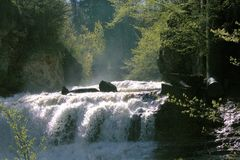 Misty Waterfall. Sunlit misty Waterfall in Willow River State Park Stock Photography