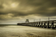 Misty Wooden Dock in Luc sur Mer, France Stock Image