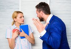 Misunderstanding between colleagues. Prejudice and personal attitude to employee. Tense conversation or quarrel between. Colleagues. Boss and worker discuss royalty free stock images