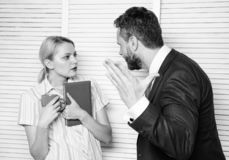 Misunderstanding between colleagues. Prejudice and personal attitude to employee. Tense conversation or quarrel between. Colleagues. Boss and worker discuss stock photography