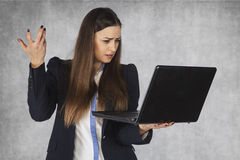 Misunderstanding of information on the Internet. Business woman royalty free stock images