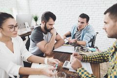 Misunderstanding during a meeting between colleagues. They are making nervous conversation in the office. stock images