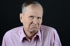 Misunderstanding. Senior with lips down not understanding what is going on Stock Photo