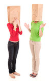 Misunderstanding, two girls with paper heads Royalty Free Stock Photo
