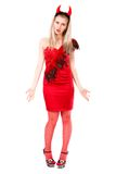Misunderstanding young woman in a devil costume Royalty Free Stock Image