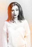 Misunderstanding young woman in a white sweater Stock Photos
