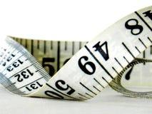 Misura di nastro isolata su bianco Fotografia Stock