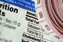 Misura di nastro vicino ai fatti di nutrizione, Fotografia Stock