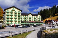 MISURINA, ITALY, 14 OCTOBER, 2018: The elegant Grand Hotel Misurina - Blu Hotels on the lake shore in a beautiful autumn day. Lake Misurina or Lago di Misurina stock image