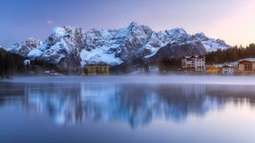 Misurina Lake, on Dolomites (Italian Alps) seen at sunrise. Sora. Piss mountain in the background. South Tyrol, Dolomites, Italy royalty free stock images