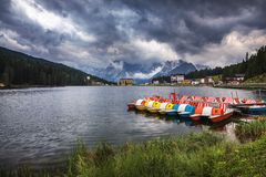 Misurina Lake in the Dolomites mountains in Italy near Auronzo d. I Cadore on a cloudy day, Sorapiss mountain in the background. South Tyrol, Dolomites, Italy Royalty Free Stock Photos