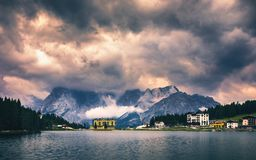 Misurina Lake in the Dolomites mountains in Italy near Auronzo d. I Cadore on a cloudy day, Sorapiss mountain in the background. South Tyrol, Dolomites, Italy stock photo