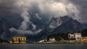 Misurina Lake in the Dolomites mountains in Italy near Auronzo d. I Cadore on a cloudy day, Sorapiss mountain in the background. South Tyrol, Dolomites, Italy stock images