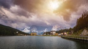 Misurina Lake in the Dolomites mountains in Italy near Auronzo d. I Cadore on a cloudy day, Sorapiss mountain in the background. South Tyrol, Dolomites, Italy stock photography