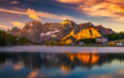 Misurina Lake in the Dolomites mountains in Italy near Auronzo d. I Cadore on a cloudy day, Sorapiss mountain in the background. South Tyrol, Dolomites, Italy royalty free stock photography