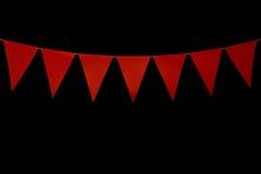 Mit dem Kopfe stoßen, sieben rote Dreiecke auf Schnur für Fahnenmitteilung Lizenzfreie Stockbilder