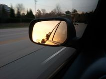 Mit dem Sun an Ihrer Rückseite Stockbild