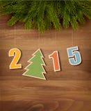 2015 mit einem Weihnachtsbaum auf hölzernem Hintergrund Stockfotografie