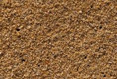 Mit gelbem Sand von der südlichen Küste. Beschaffenheit. Hintergrund Stockfotografie