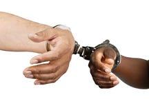 Mit Handschellen gefesselt Lizenzfreie Stockbilder