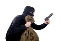 Mit Kapuze Räuber mit einer Tasche des Geldes Stockbilder