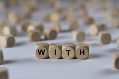 Mit - Würfel mit Buchstaben, Zeichen mit hölzernen Würfeln Lizenzfreie Stockfotografie