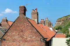 Mit Ziegeln gedeckte englische Häuser Stockbild