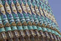 Mit Ziegeln gedeckte Wand Stockfotos
