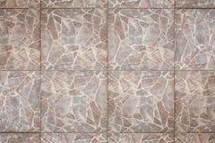 Mit Ziegeln gedeckter Fußboden Stockbilder