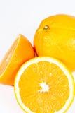 Mitad anaranjada aislada de la fruta Foto de archivo
